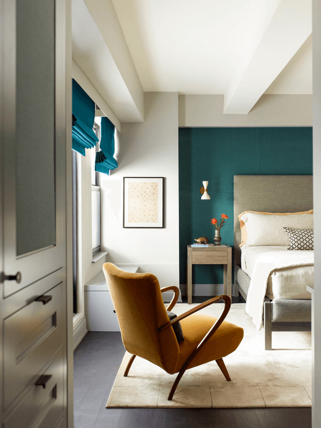 teal green accent wall in bedroom