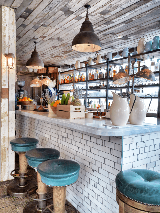 restaurant bar with teal green stools