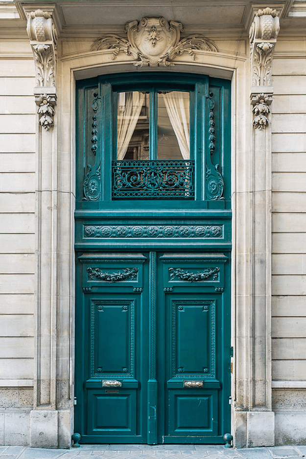 teal green french door in stone home front