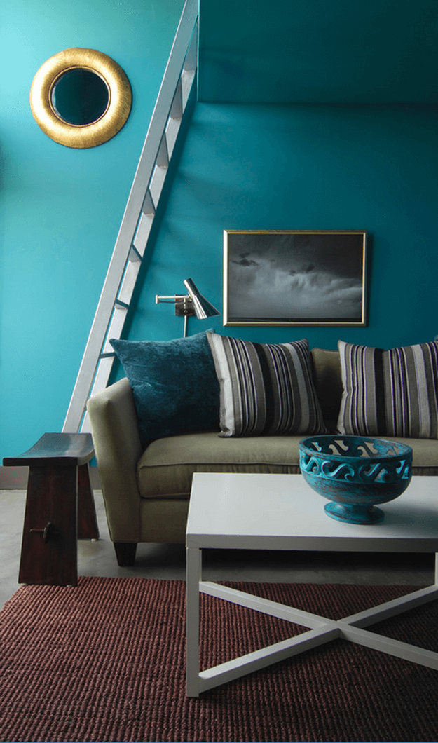 teal blue living room with khaki green sofa