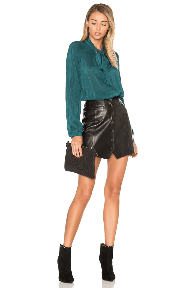 teal green blouse with black leather skirt