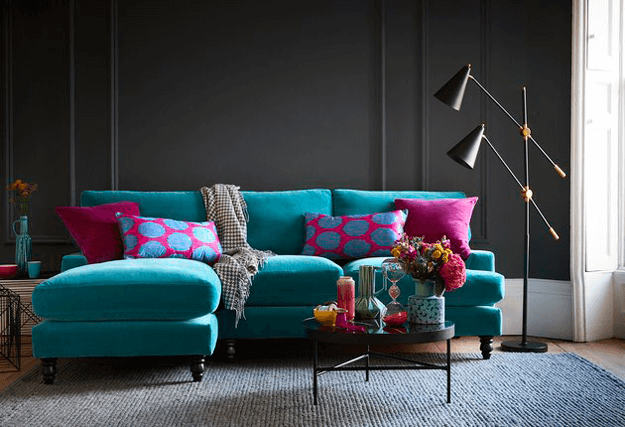 teal blue sectional sofa in black room
