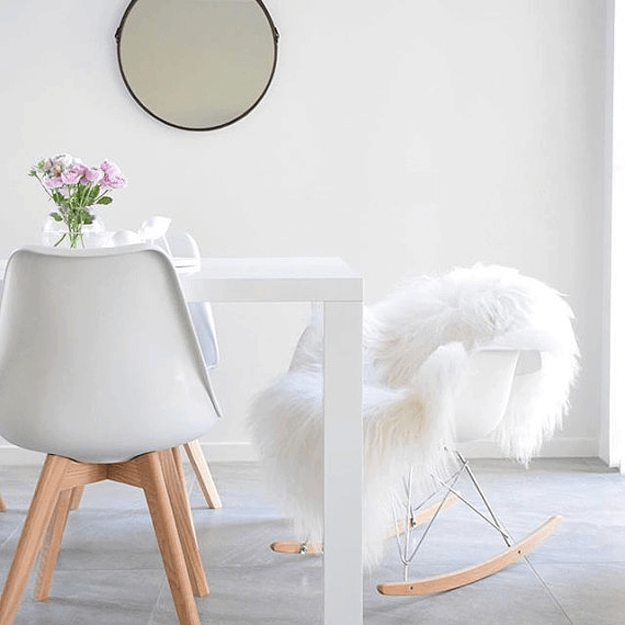 white sheepskin rug draped over chair