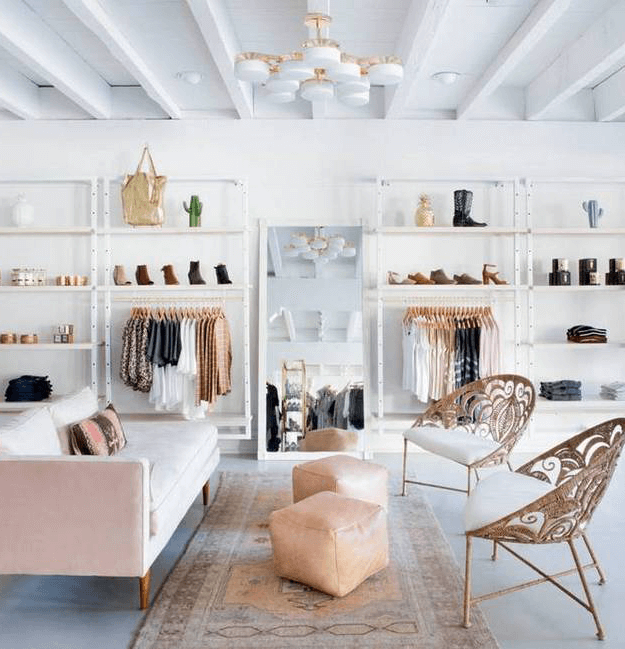 white retail shop interior with blush pink accents