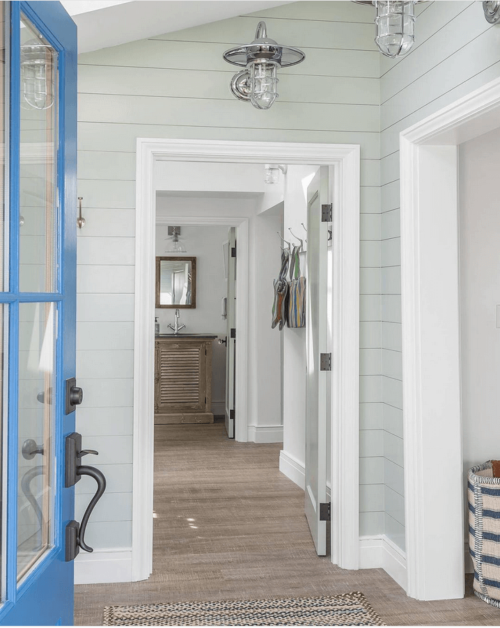 coastal style cottage entry with french blue door
