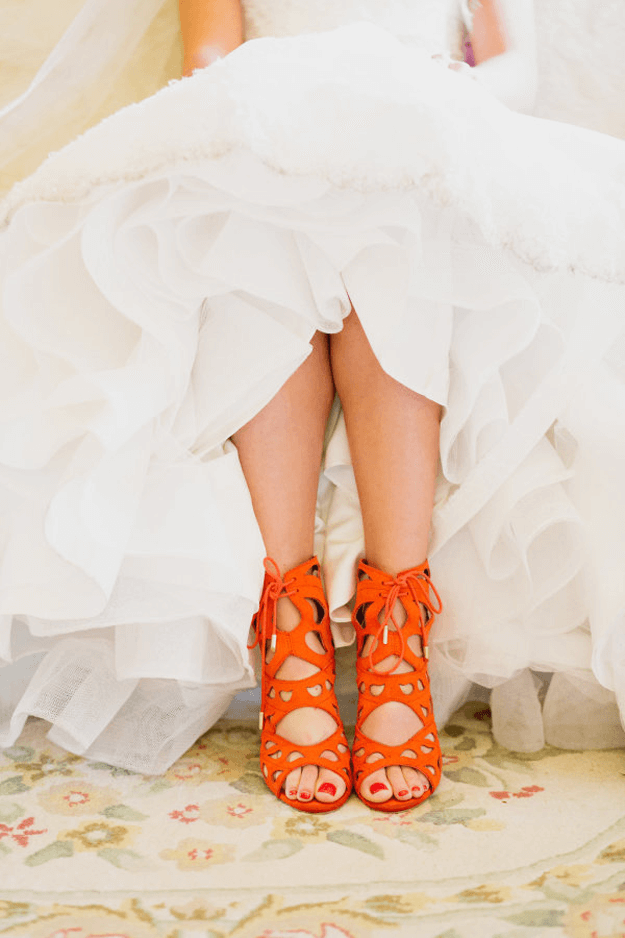 bride in wedding dress with burnt orange heels