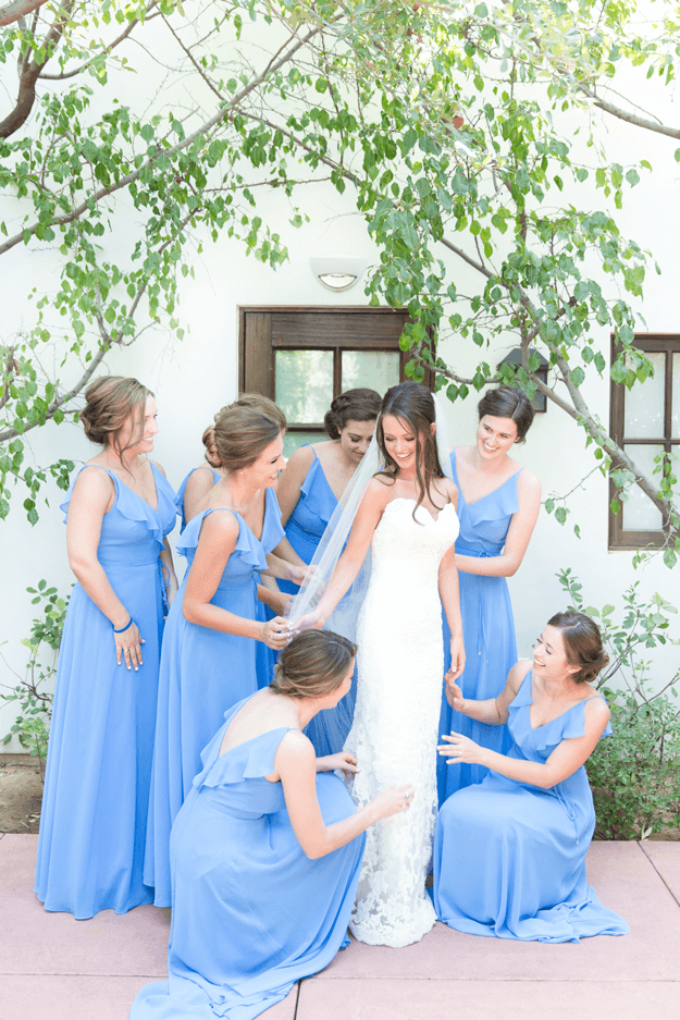 bridesmaids in french blue dresses surrounding bride