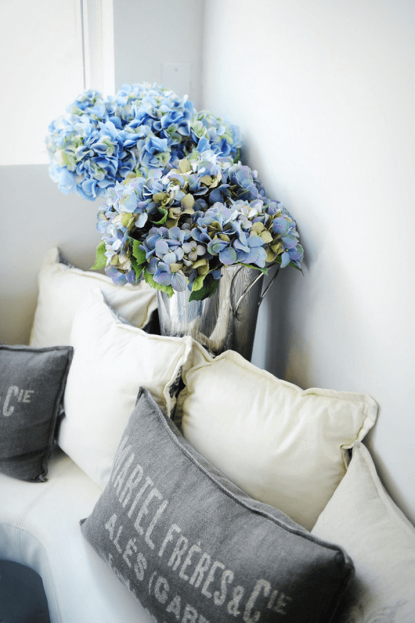 ivory and gray living room with blue flowers