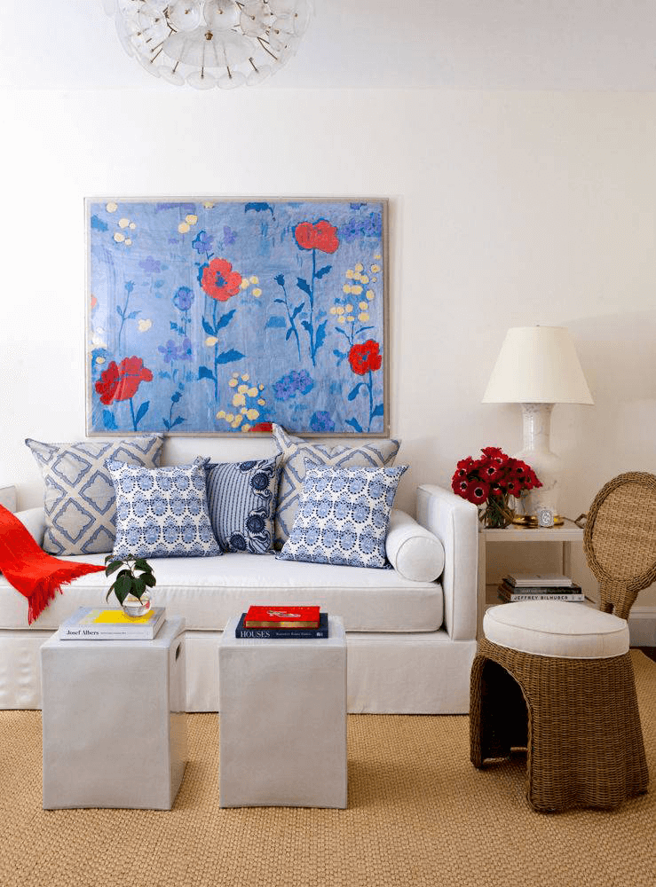 living room with bright blue flower painting