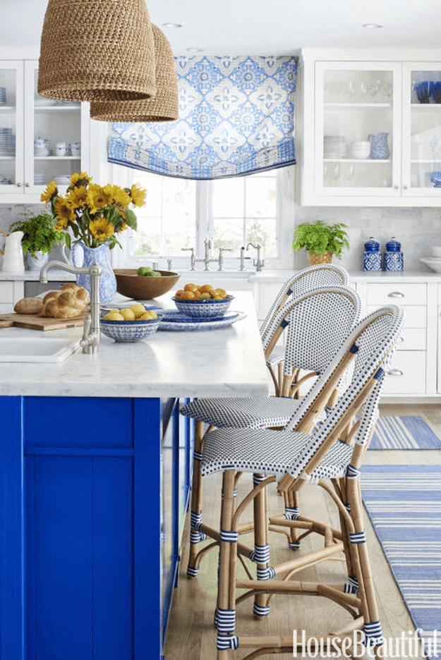 white kitchen with cobalt blue accents