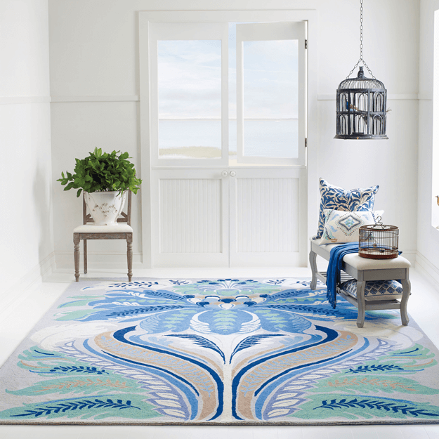 white coastal style interior with marine blue floral rug