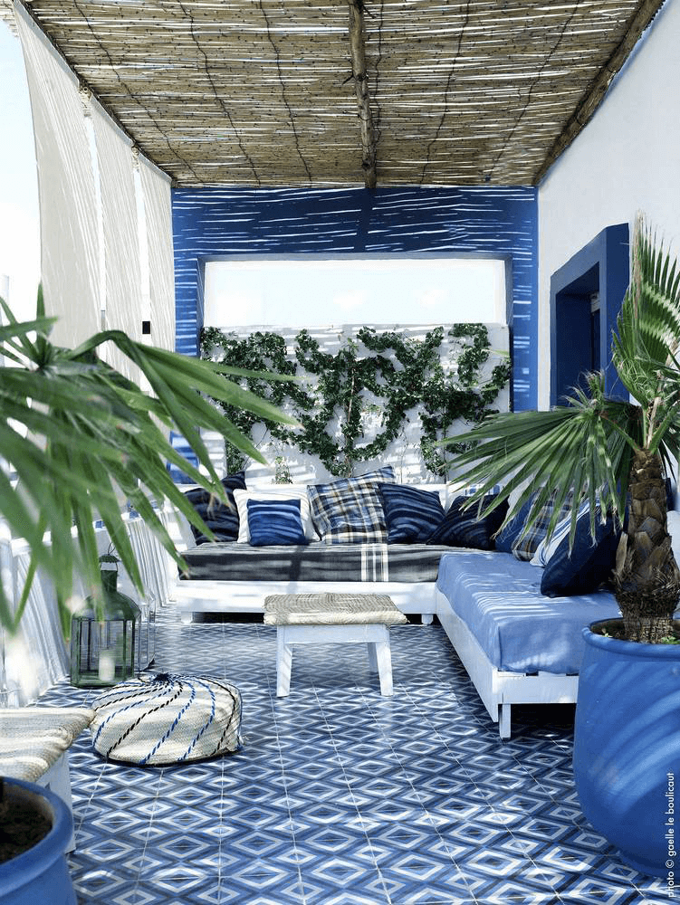 blue and white patio with palm plants