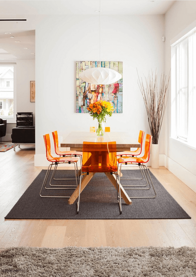 modern dining room with orange chairs