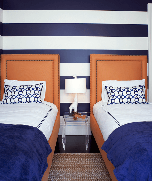 navy blue and white striped bedroom with leather headboards