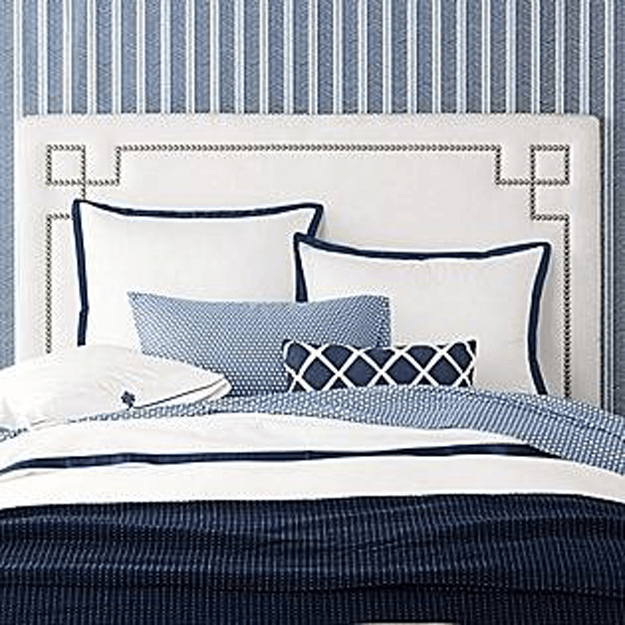 navy blue nad white bedroom with herringbone wallpaper