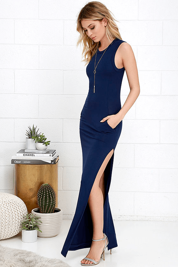 long navy blue dress against white background