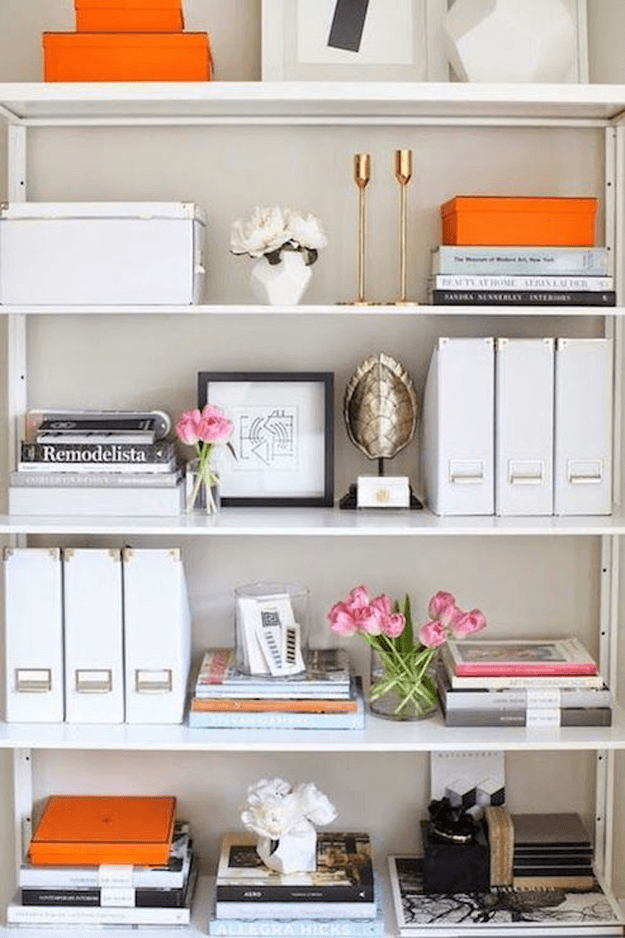 white shelves with orange accents
