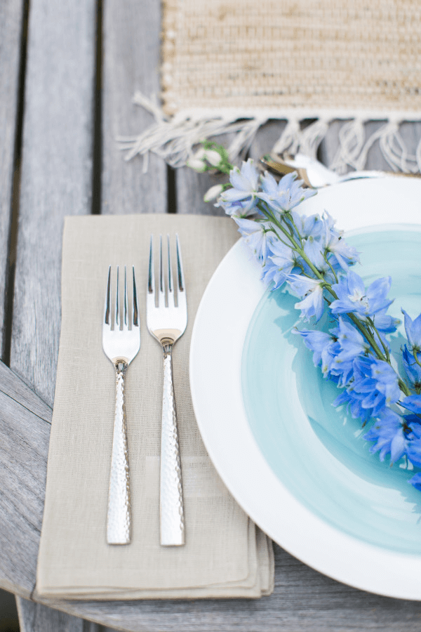 outdoor table setting with blue flowers