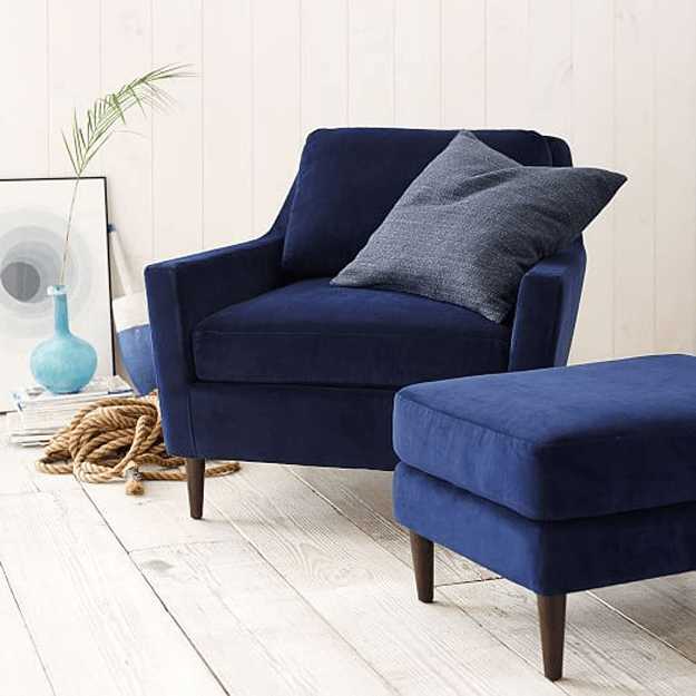 navy blue chair and ottoman in cottage style interior