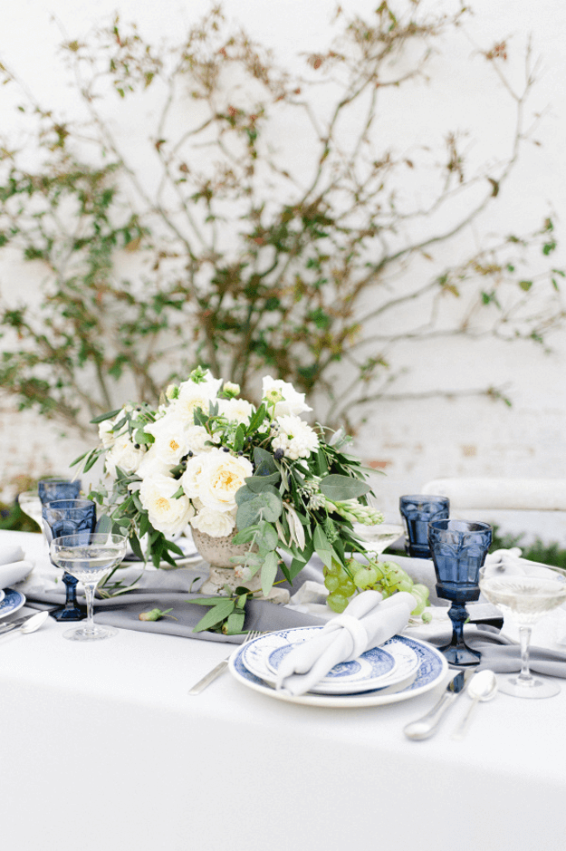 wedding reception table with cobalt blue glasses
