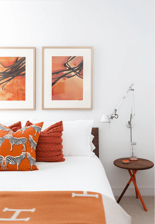 white bedroom with burnt orange accents