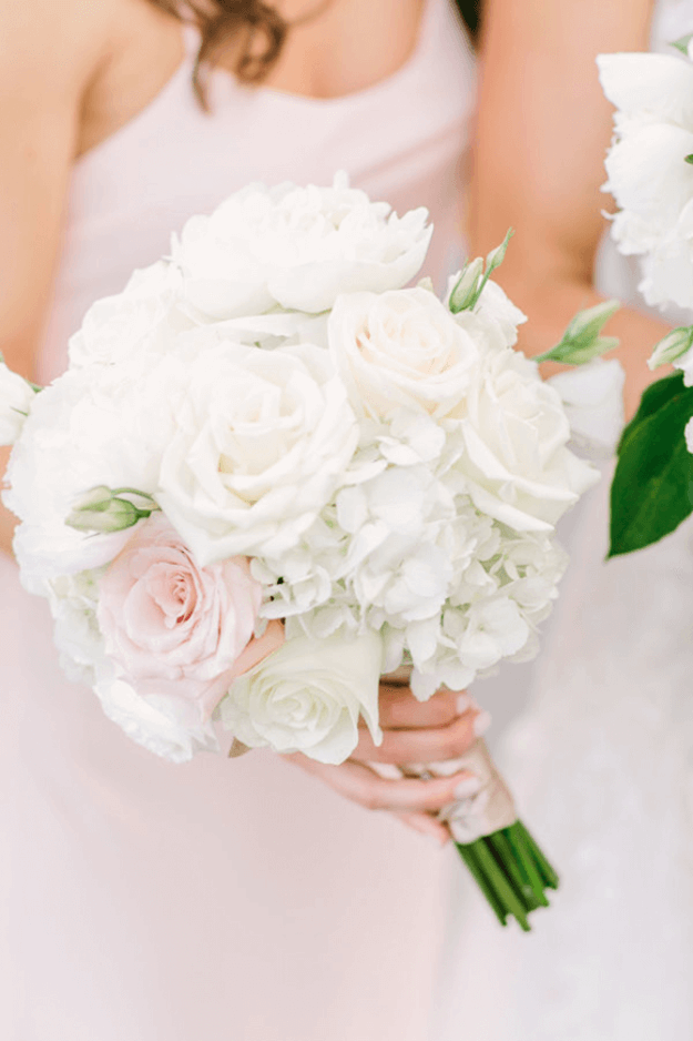white flower bouquet and blush pink dress
