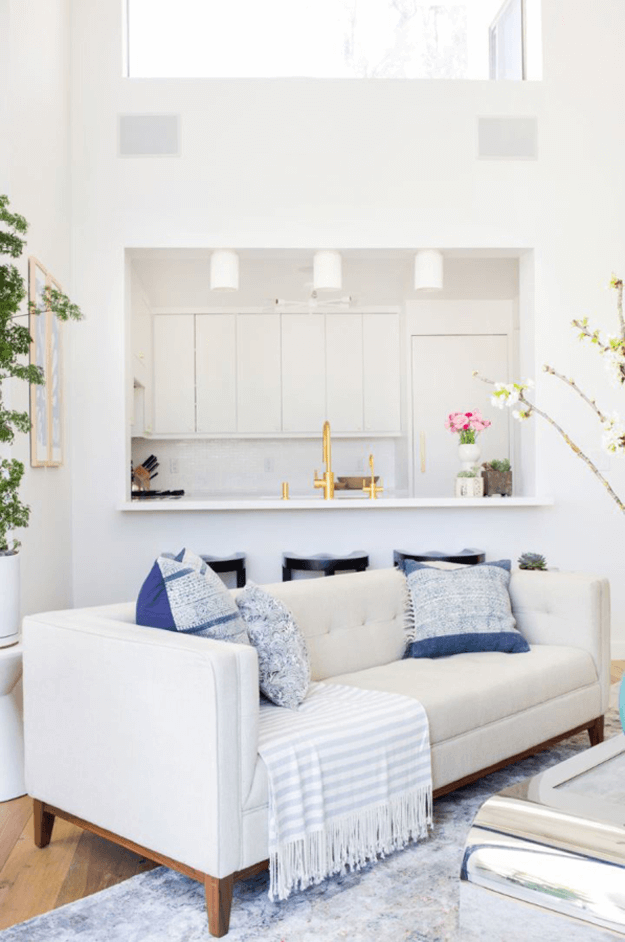 white conto living room with navy blue pillows