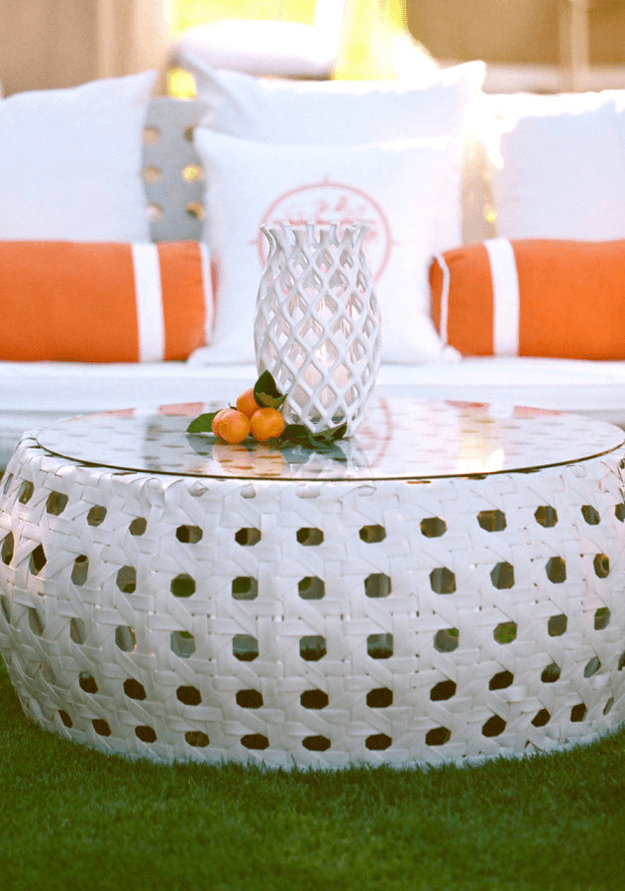 white outdoor furniture with orange accent piillows