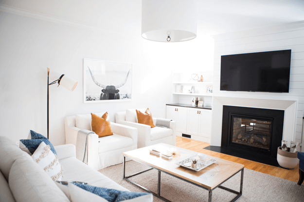 white modern living room with navy black and burnt orange accents