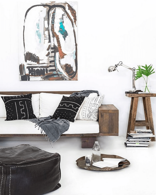 white tribal style interior with black mudcloth pillows