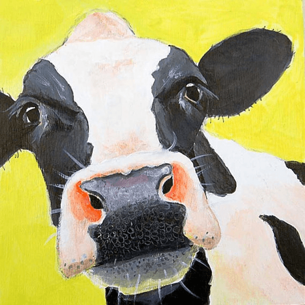 black and white cow painting on yellow background