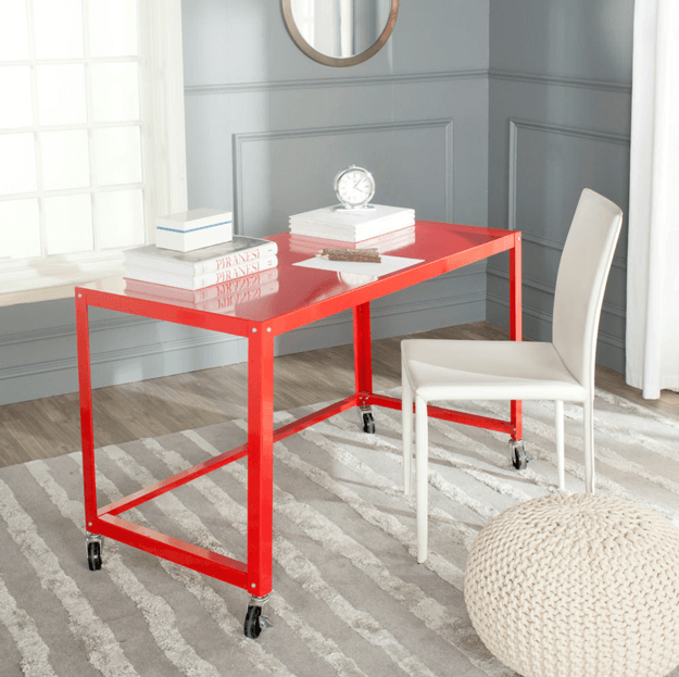 bright red metal desk on casters