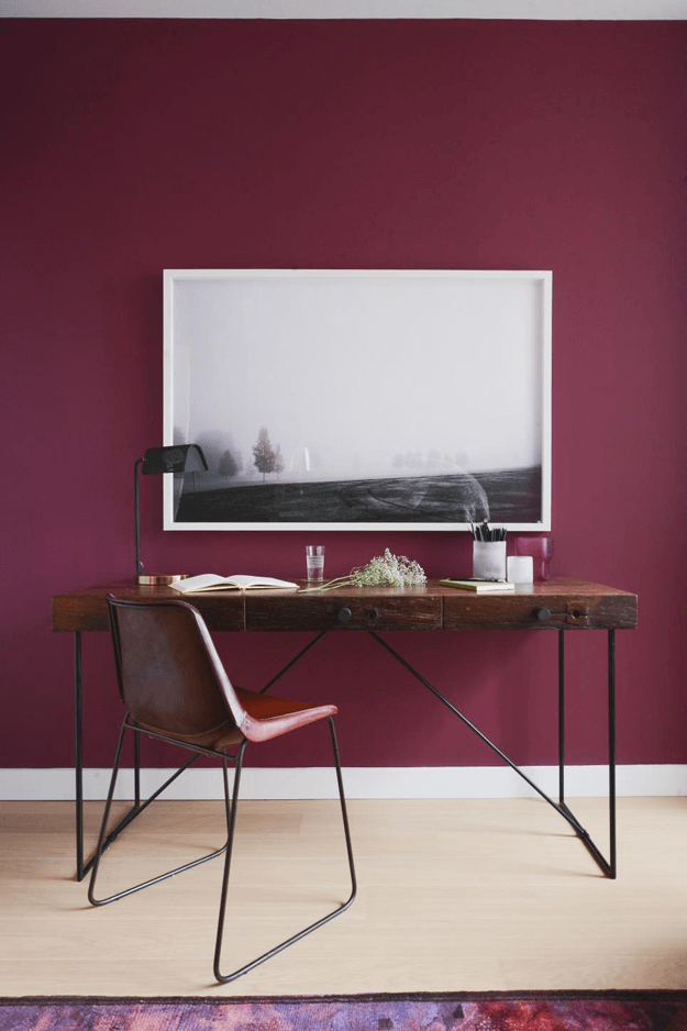 burgundy home office with reclaimed wood desk