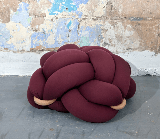 burgundy floor knot cushion