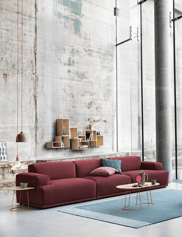 industrial style living room with burgundy sofa