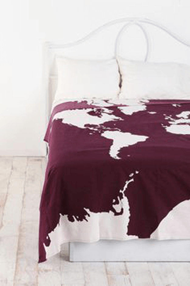 white bedroom with burgundy atlas blanket