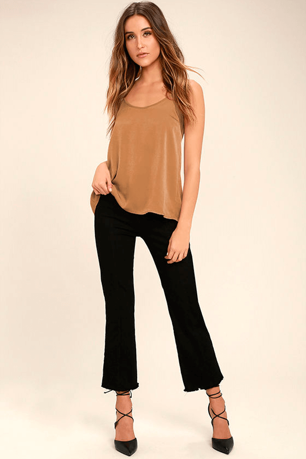light brown satin top with black pants