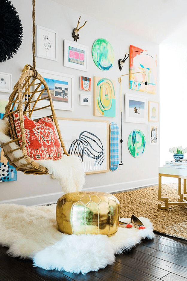 eclectic interior with swinging chair and bright red accents