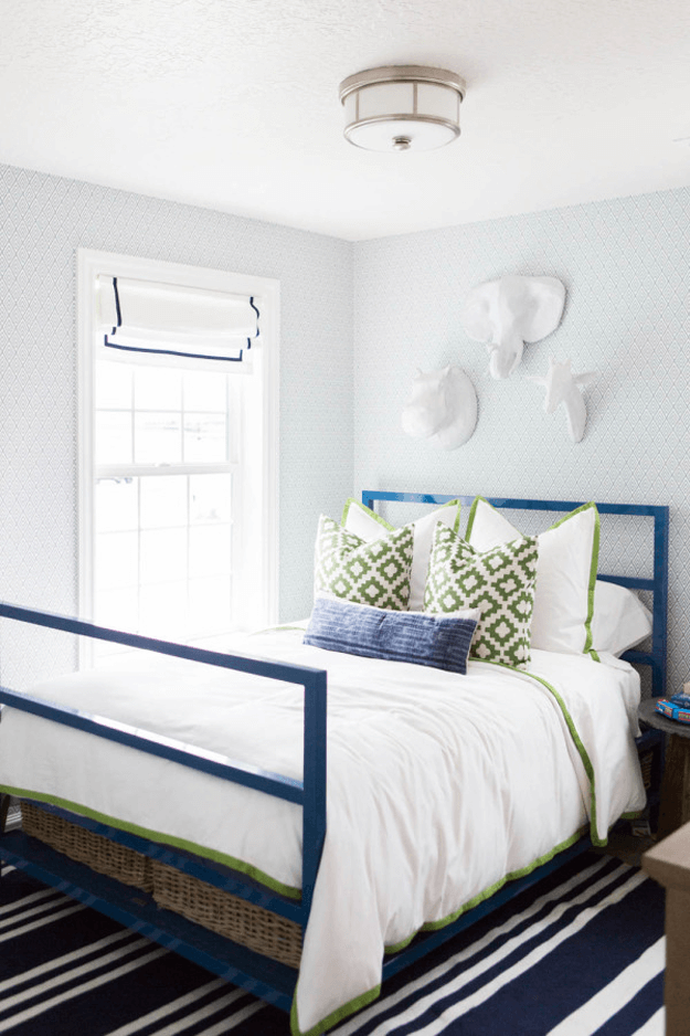 gray bedroom with navy blue and avocado green accents