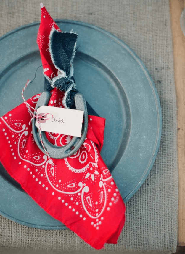 farm inspired table setting with red hankerchief napkins