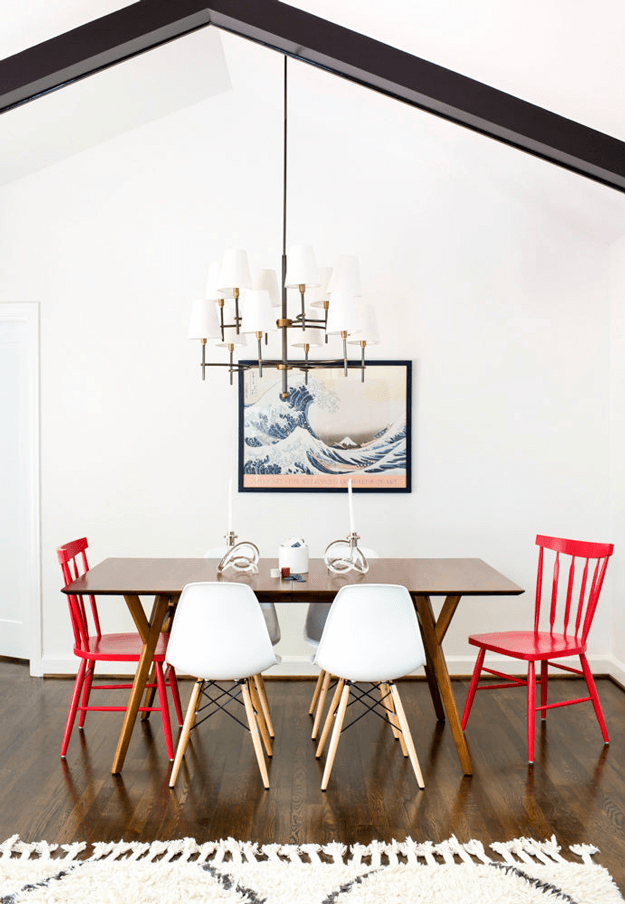 white mid-century style dining room with bright red chairs