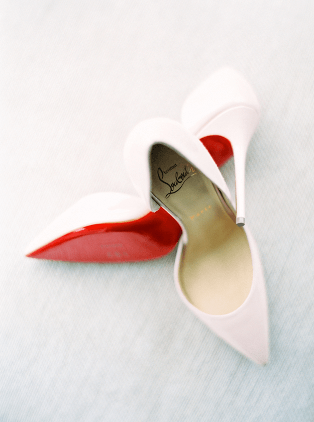 pale pink high heels with bright red sole