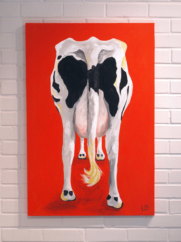black and white cow rear end painting on red background