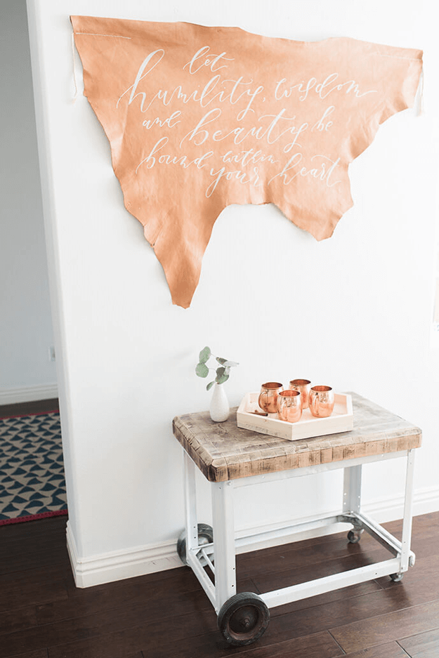 camel brown wall art with white script