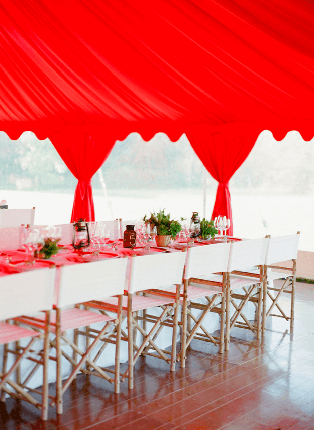 wedding reception with bright red tent