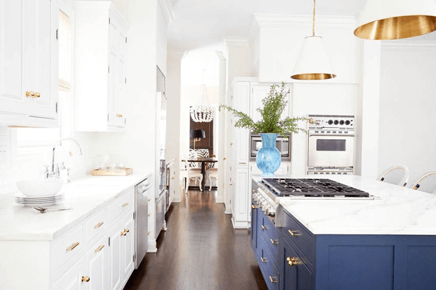 white kitchen with navy blue island cabinets