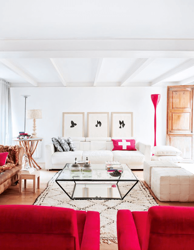 white living room with bright red accents