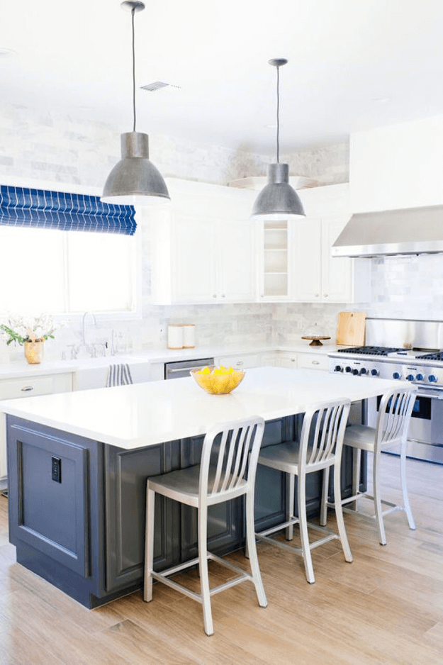 white kitchen with navy blue and stainless steel accents