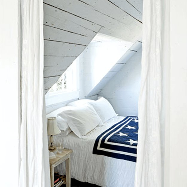 white cottage style bedroom with american flag throw blanket