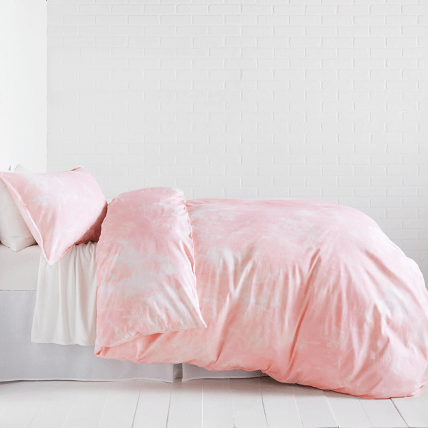 blush pink duvet cover in white bedroom